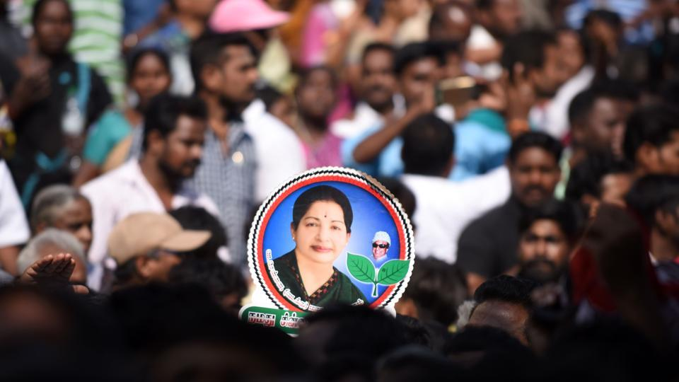 Supporters gather to pay their respects to the late Tamil Nadu chief minister JJayalalithaa Jayaram ahead of her funeral, at Rajaji Hall in Chennai.