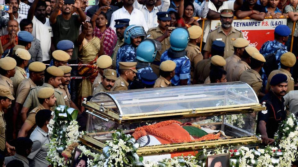 Security personnel carry late Tamil Nadu chief minister J Jayalalithaa's mortal remains during her funeral procession in Chennai.