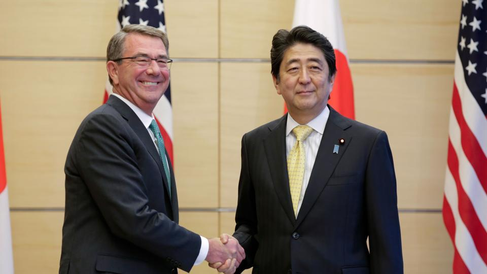US defense secretary Ash Carter (L) with Japan Prime Minister Shinzo Abe in Tokyo on Tuesday.