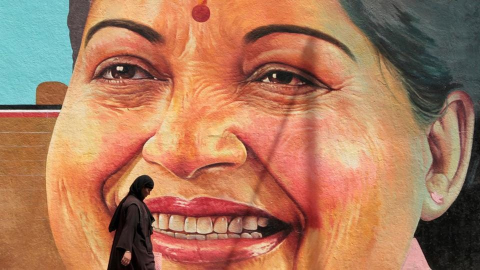 A woman walks past a portrait of J. Jayalalithaa, Chief Minister of the southern state of Tamil Nadu, in Chennai.