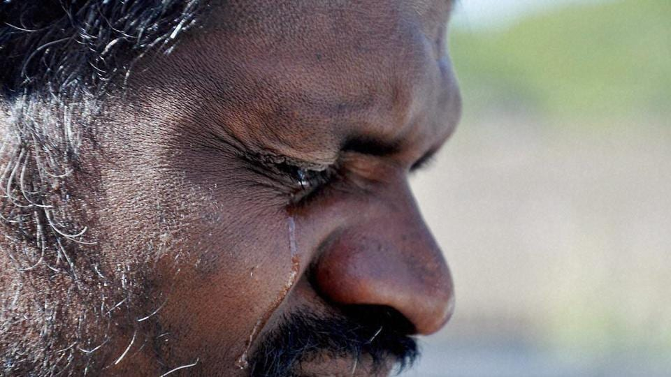 A supporter of AIADMK chief J Jayalalithaa in tears while paying tribute to her leader in Chikmagalur in Karnataka.  (PTI)