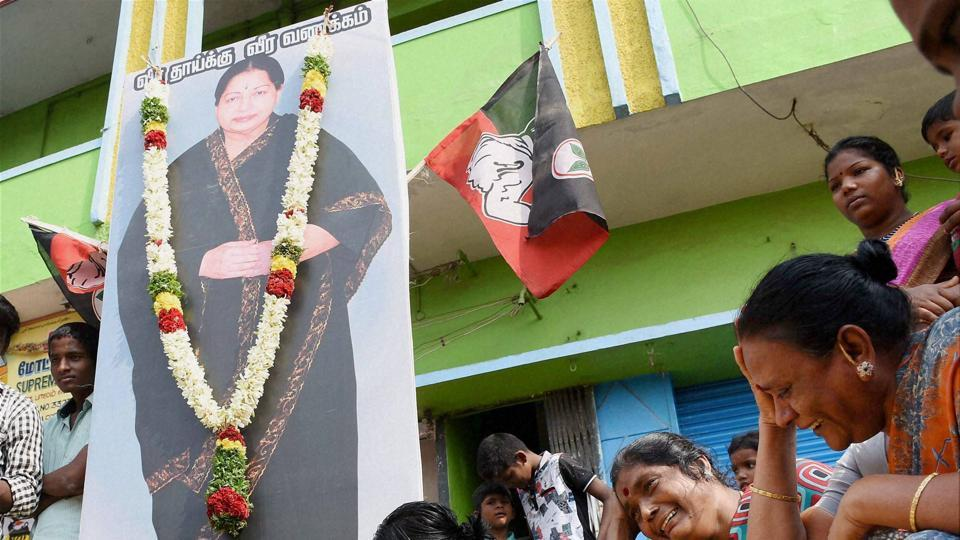 Supporters mourn the death of AIADMK leader J Jayalalithaa in Madurai on Tuesday.
