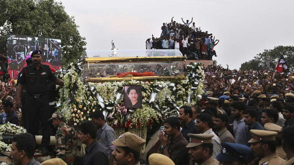 A glass casket carrying body of a powerful politician and former film actress JJayalalithaa is taken in a funeral procession in Chennai. (AP)