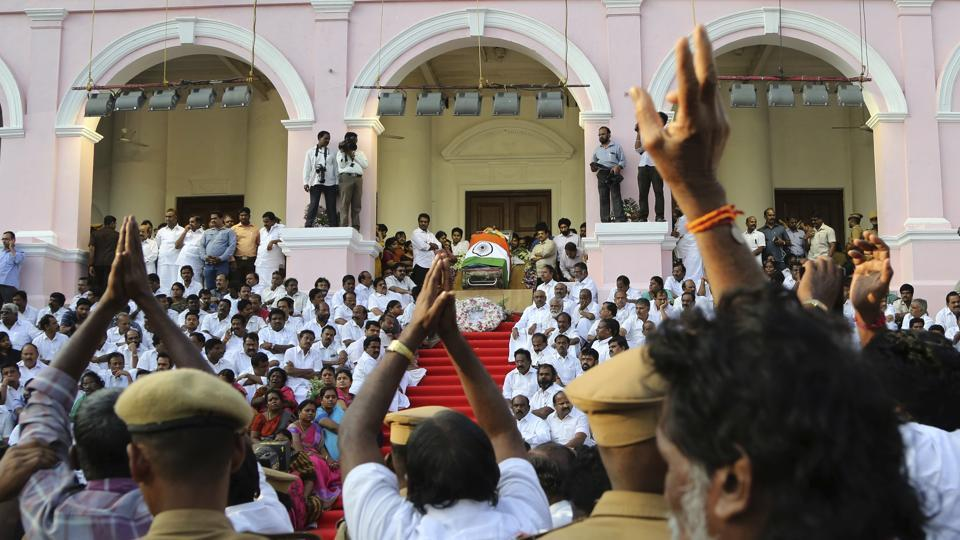 People pay their respects to Tamil Nadu's former chief minister Jayaram Jayalalithaa, wrapped in the national flag, at Rajaji auditorium in Chennai, on December 6, 2016.