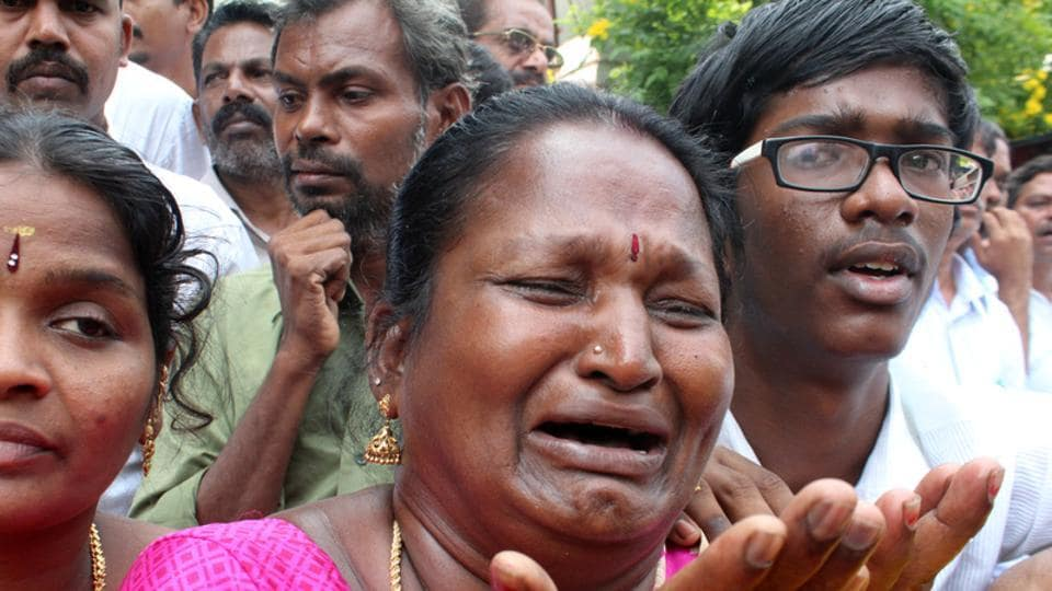 A supporter of Tamil Nadu Chief Minister Jayalalithaa Jayaraman cries outside a hospital where the politician was being treated in Chennai.