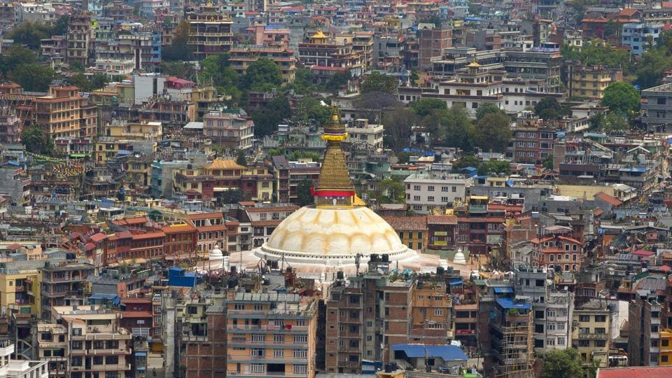 The Boudhanath Stupa stands amongst buildings four days after the April 25 massive earthquake in Kathmandu last year.