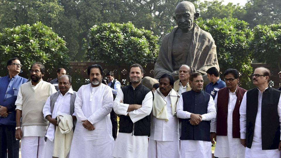 New Delhi: Congress Vice president Rahul Gandhi with MP's of Opposition parties during a protest outside Parliament against the government's move to demonetise high tender notes, in New Delhi on Wednesday. PTI Photo by Kamal Kishore (PTI11_23_2016_000036B)