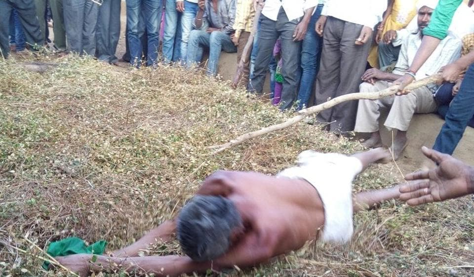 A member of Rajjad community rolling over thorny bushes in Betul.
