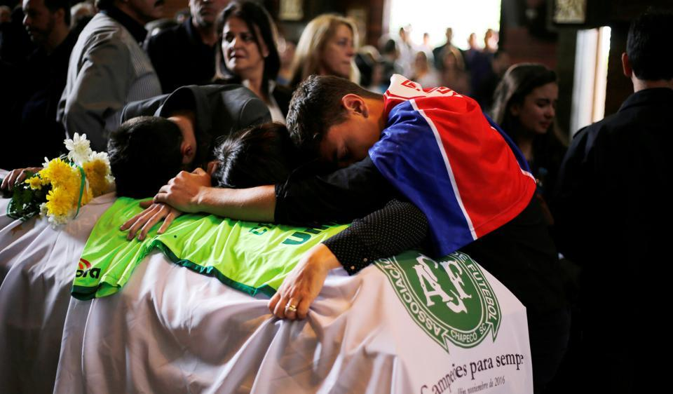 Relatives of Chapecoense club head coach Caio Junior, who died in the plane crash in Colombia, participate in a ceremony to pay tribute to him in Curitiba, Brazil.