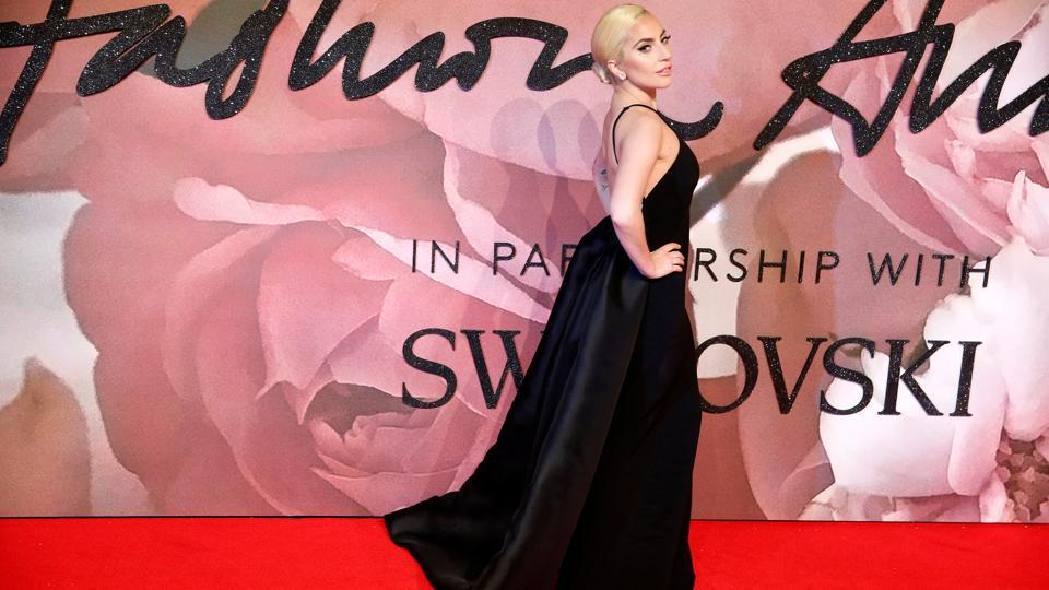 Hosted by Jack Whitehall, the ceremony saw the best of the British and international fashion industries joined by a glamorous line-up of guests and presenters. Here, singer Lady Gaga poses on the red carpet. (Reuters)
