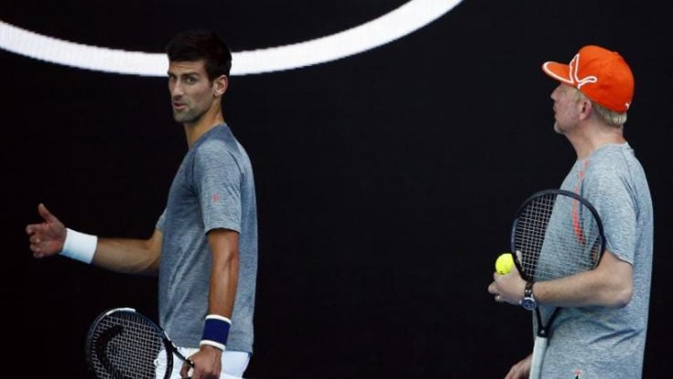 Novak Djokovic and Boris becker (right) during a training session at Australian Open in 2016.