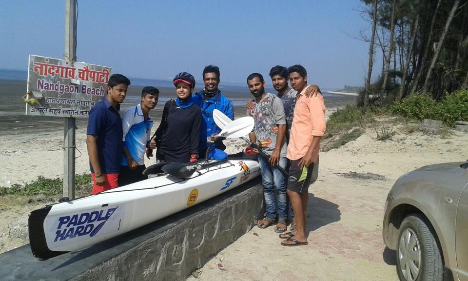 Kayaker Kaustubh Khade (middle) with his cyclist girlfriend Shanjali Shahi beside her at Nandgaon coast with locals.