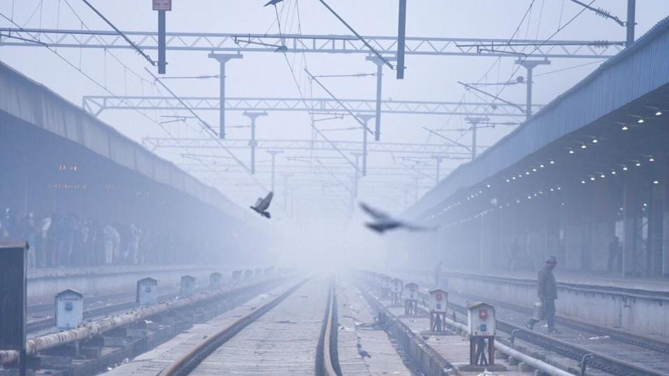 Fog blankets the Anand Vihar railway station in East Delhi on December 7, 2016. The weather condition has caused many trains to be delayed due to low visibility.