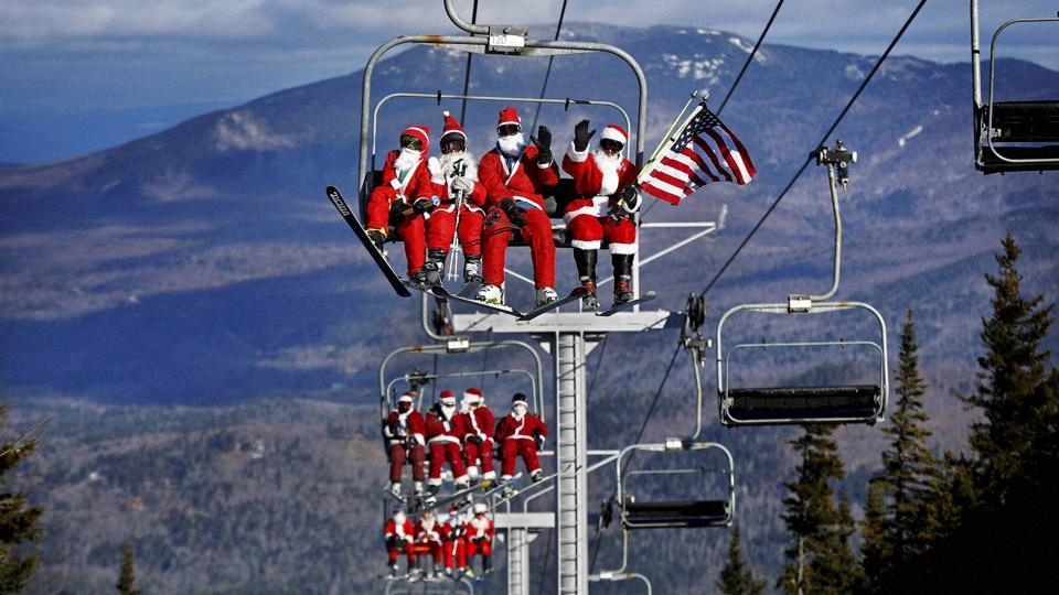 Some of the skiers dressed as Santa Claus ride the chairlift. (AP)