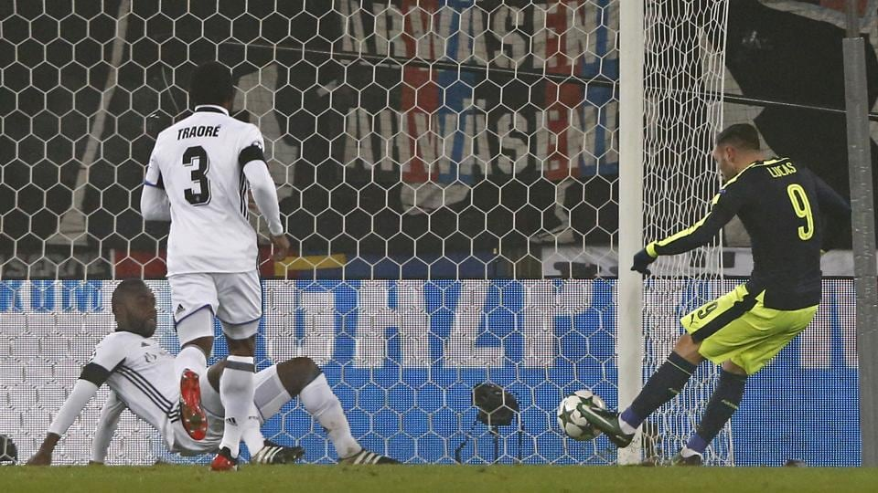 Arsenal's Lucas Perez scores the first goal against FCBasel in their Champions League match on Tuesday.