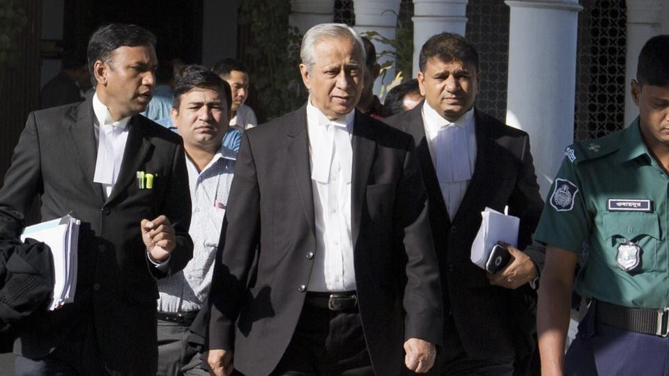 Attorney General of Bangladesh, Mahbubey Alam, center, walks out of the Supreme Court after the hearing of a review petition relating to the death sentence of Harkatul Jihad leader, Mufti Abdul Hannan, in Dhaka, Bangladesh, Wednesday, Dec. 7, 2016. The court upheld the death sentence against Hannan and two of his accomplices found guilty of orchestrating a 2004 grenade attack against Bangladesh-born British High Commissioner, Anwar Choudhury, as he visited a popular Islamic shrine in the north-eastern city of Sylhet. (AP Photo)