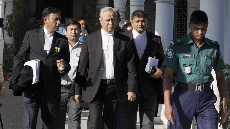 Attorney general of Bangladesh, Mahbubey Alam (center) walks out of the Supreme Court after the hearing of a review petition relating to the death sentence of Harkatul Jihad leader, Mufti Abdul Hannan, in Dhaka.