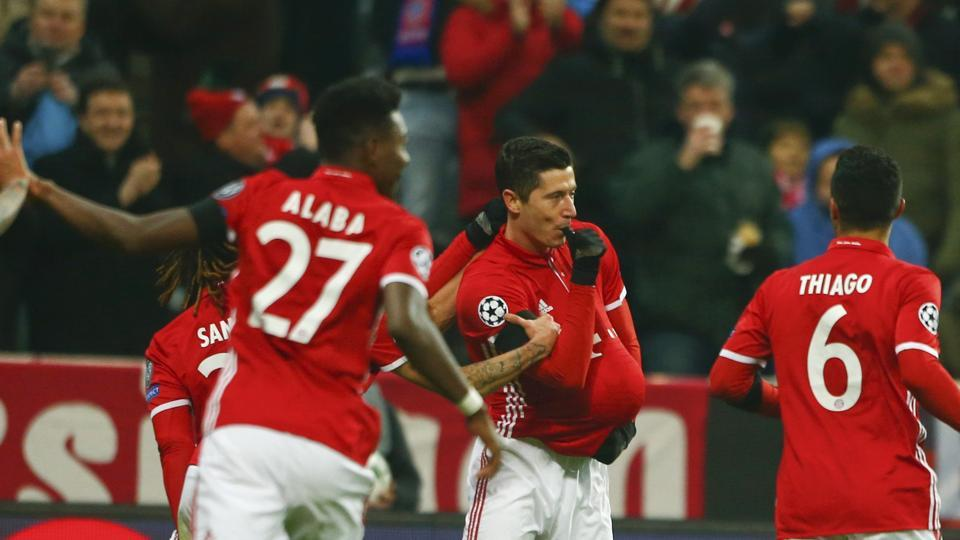 Bayern Munich's Robert Lewandowski celebrates after scoring against Atletico Madrid in their Champions League match at the Allianz Arena in Munich on Tuesday. Munich beat Atletico 2-1 but the Spanish side, with 15 points,  advanced to the next stage as Group D winners, ahead of Bayern Munich (12). (REUTERS)