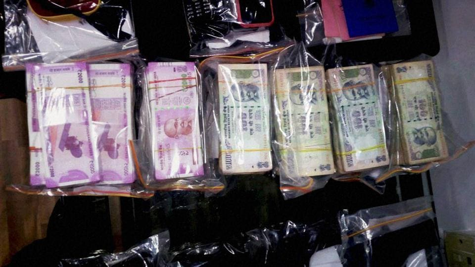 Two people were detained on Wednesday with Rs 70 lakh in the new currency notes of Rs 2,000.