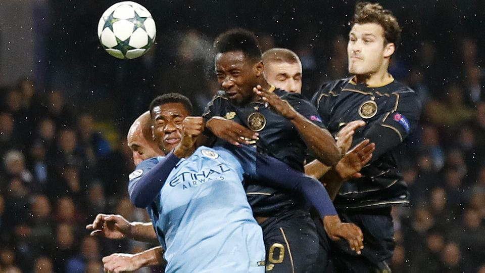 Manchester City's Oluwatosin Adarabioyo fights for the ball with Celtic players during their Champions League match on Tuesday. Manchester City and Celtic played out a 1-1 draw in a rough match. City, who secured nine points from their six matches,  advanced to the final 16 stage as the second placed team from Group C behind Barcelona. (REUTERS)