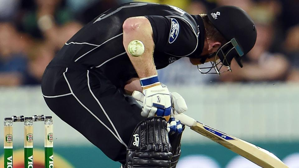 New Zealand's batsman James Neesham gets hit by a Mitchell Starc delivery during the second ODI in Canberra on Tuesday.