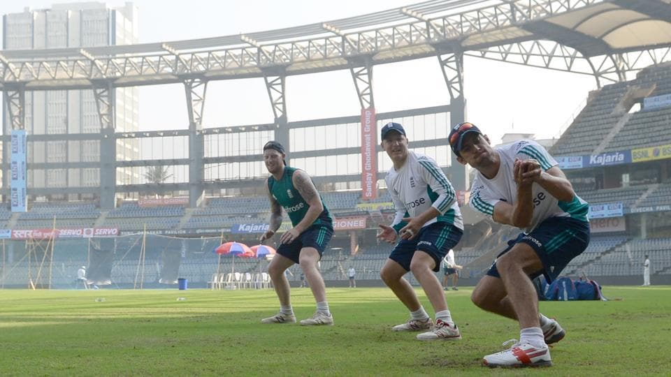 England's captain Alastair Cook (R) takes a catch during a training session at the Wankhede stadium ahead of the fourth test cricket match against India. (AFP)