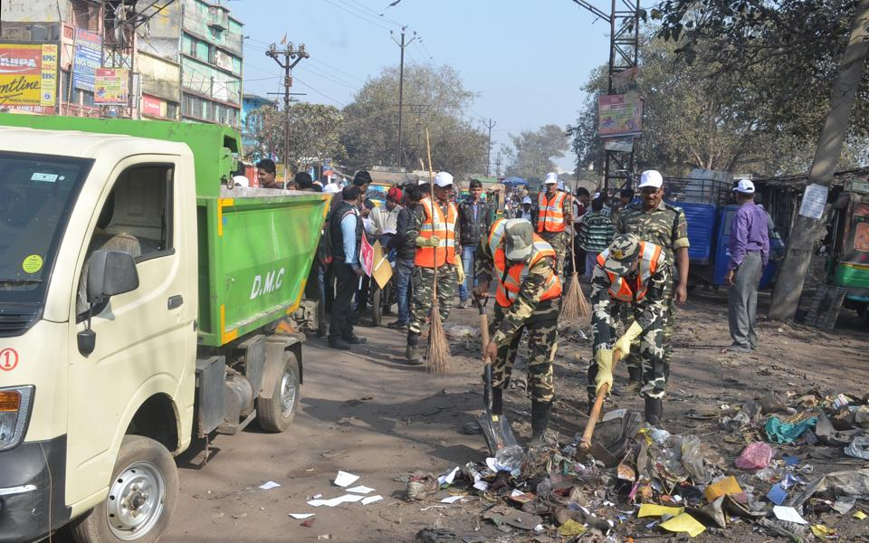 Police personnel take part in a cleanliness drive in Dhanbad on Wednesday.