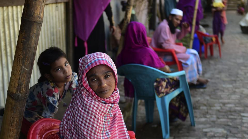 Myanmar Rohingya refugees look on in a refugee camp in Teknaf, in Bangladesh's Cox's Bazar.