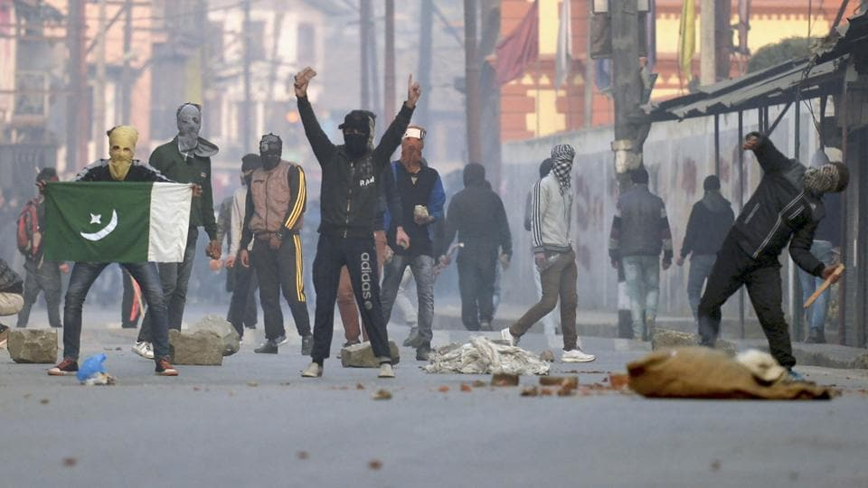 Kashmiri protestors clash with police during a rally in downtown Srinagar.
