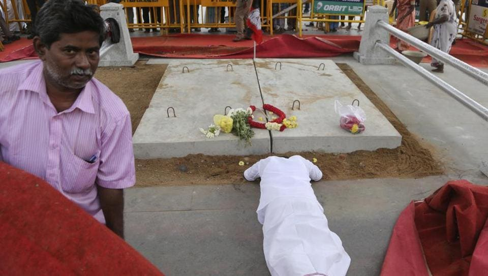 A supporter of late Tamil Nadu chief minister J Jayalalithaa, prostrates next to her place of burial in Chennai.