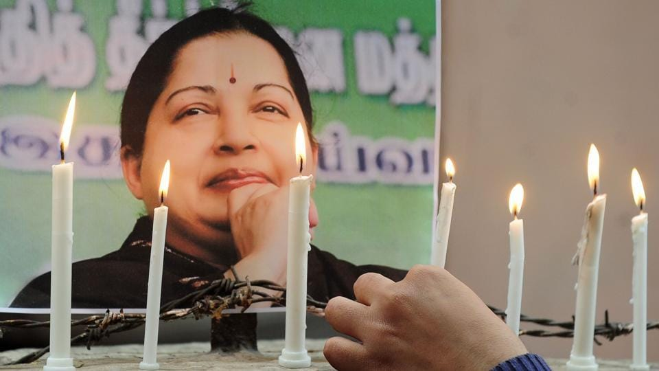 Supporters of late Tamil Nadu chief minister J Jayalalithaa pay tribute after her death, in Allahabad.