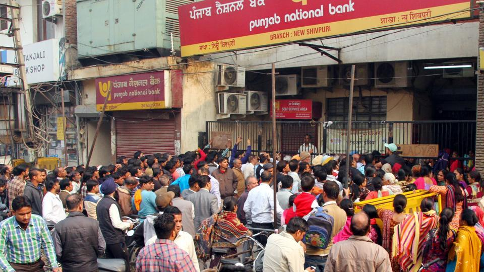People outside a bank in Ludhiana on Wednesday.