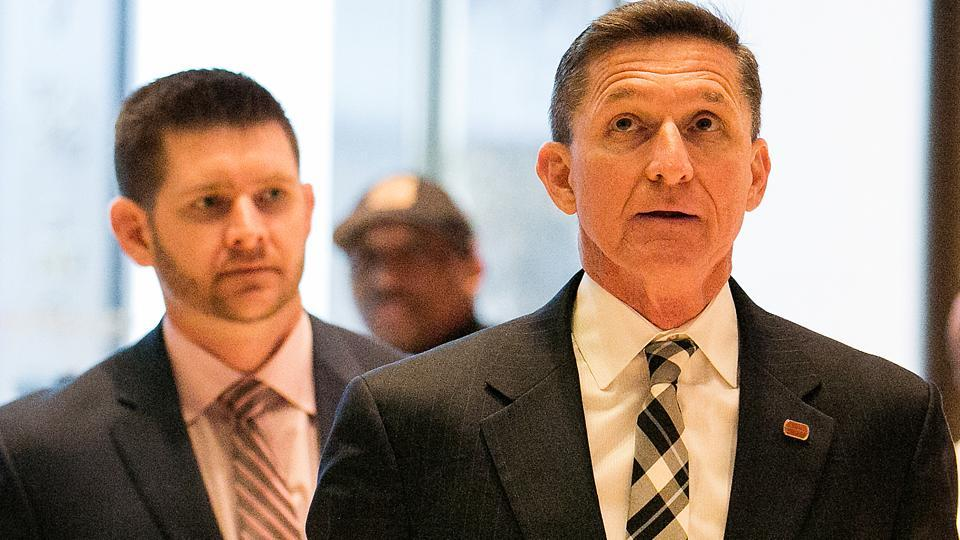 Michael Flynn, foreground, whom President-elect Donald Trump tapped to be his national security advisor, arrives at Trump Tower in New York for meetings on November 17,  followed by his son Michael Flynn Jr.