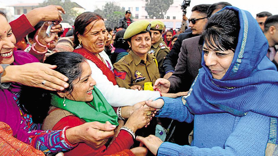 Mehbooba Mufti interacts with members of women self-help groups at Biahnah in Jammu on Wednesday..