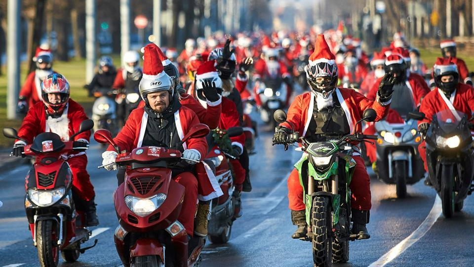People dressed as Santa Claus ride motorcycles on street in Gdansk, Poland on December 4, 2016. (REUTERS)