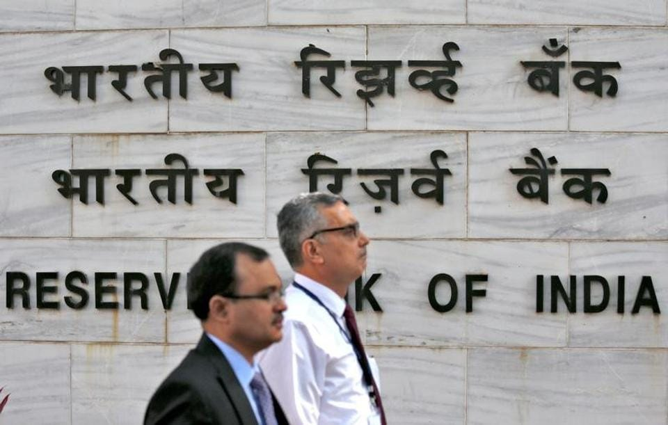 A file photo of people walking past the Reserve Bank of India  head office in Mumbai.  The central bank has refused to give information about whether the finance minister and chief economic advisor were consulted before the demonetisation decision was taken.