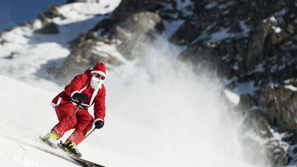 A man dressed as Santa Claus skis down the slope during a promotional event on the opening weekend in the alpine ski resort in Verbier, Saturday on December 3, 2016. Around 1200 skiers dressed as Santa Claus were granted free access to the ski resort to celebrates the ski season's opening. (AP)