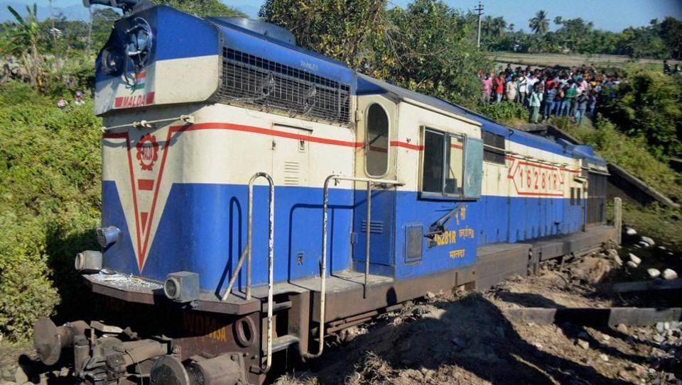 People stand around the derailed engine and compartment of Rajendra Nagar-Guwahati Capital Express in Alipurduar, Guwahati.