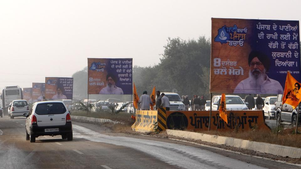 Illegal hoardings announcing the government rally on the national highway near Moga on Wednesday.
