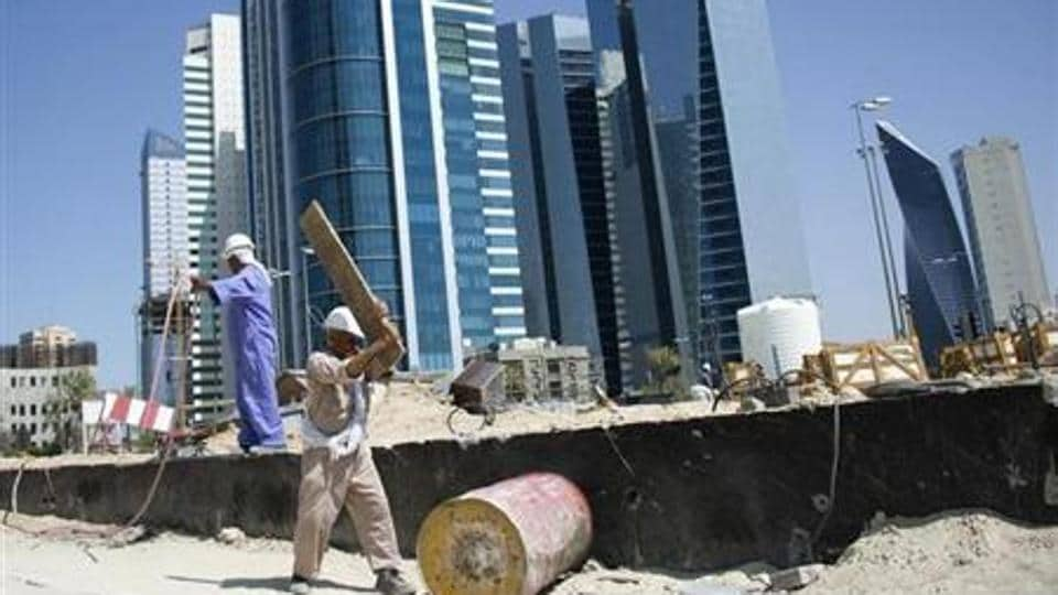 File photo of foreign workers at a building site in Kuwait City.