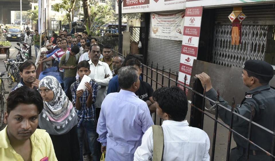 Peole queue outside Saraswat Bank in Antop Hill even before it was opened.
