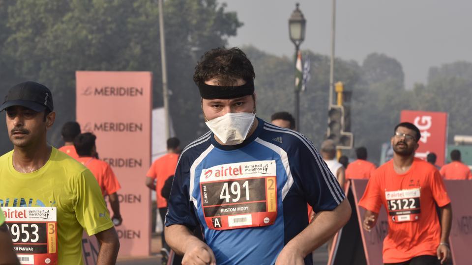 A participant runs during the Airtel Delhi Half Marathon 2016, in New Delhi on November 20.