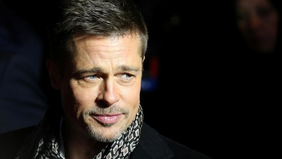 Actor Brad Pitt arrives at the premiere of the film Allied in Madrid.