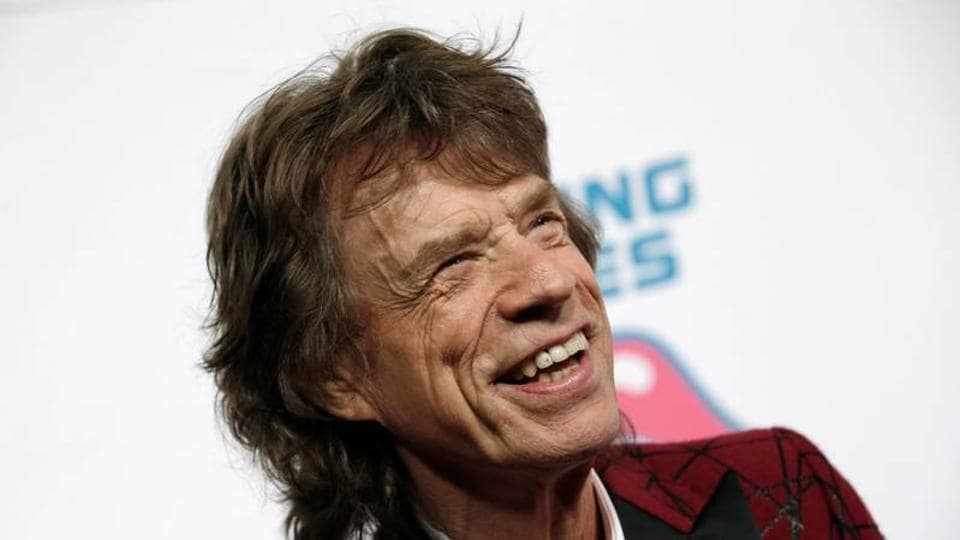 Mick Jagger of The Rolling Stones poses for photographers as the band arrives for the opening of the new exhibit 'Exhibitionism: The Rolling Stones' in the Manhattan borough of New York City.