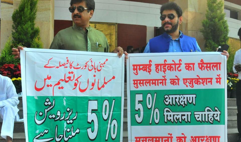 MIM MLAs Imtiyaz Ali (left) and Waris Pathan protest against the state government for scrapping Muslim reservation, outside the Vidhan Bhawan on Thursday.