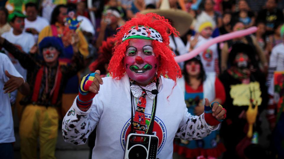 Clowns participate in a show during Salvadoran Clown Day celebrations.  El Salvador celebrates National Clown Day on the second Wednesday of December. (REUTERS)