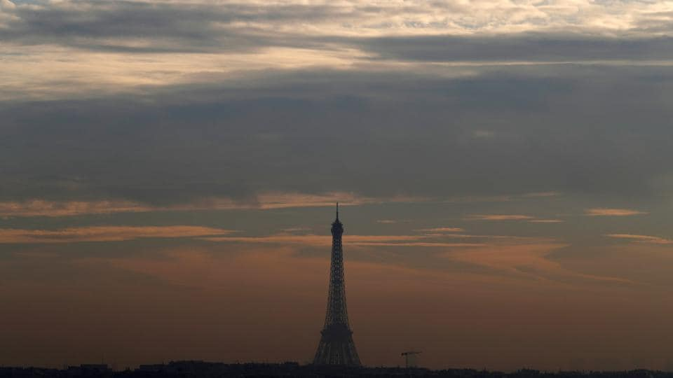 A small-particle haze hangs above the Eiffel Tower, seen on the horizon from Suresnes, near Paris, France, on December 8, 2016.