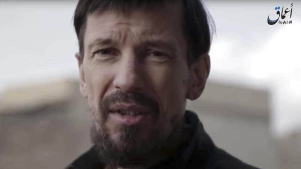 This still taken from video released Wednesday, Dec 7, 2016 by the Islamic State's Amaq news agency, shows captive British photojournalist John Cantlie in what appeared to be central Mosul.