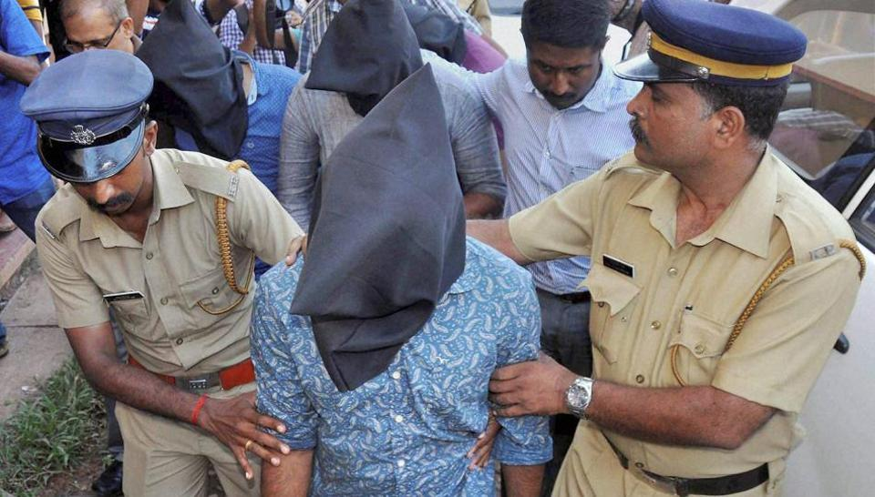leuths from the National Investigation Agency produce suspected members of Islamic State before a NIA court.
