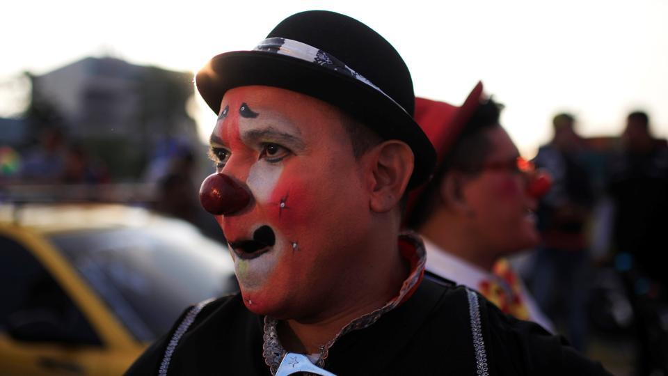 That's a pretty red nose! A clown during the parade.  (REUTERS)